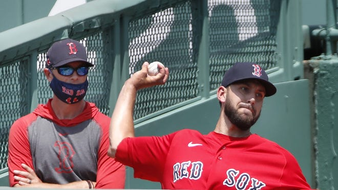 Boston's Matt Barnes works out in the bullpen during training camp earlier this week.