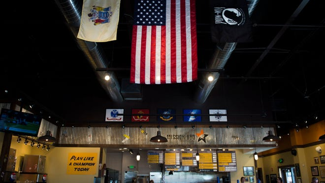 The interior of Mission BBQ in Deptford features memorabilia in support of first responders and the military.