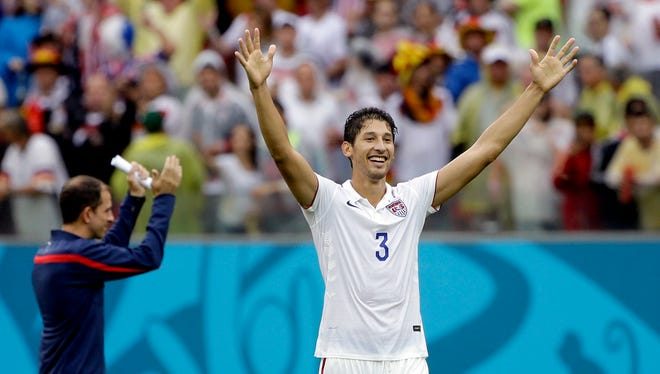United States' Omar Gonzalez celebrates after qualifying for the next World Cup round following their 1-0 loss to Germany during the group G World Cup soccer match between the USA and Germany at the Arena Pernambuco in Recife, Brazil, Thursday, June 26, 2014. (AP Photo/Ricardo Mazalan)