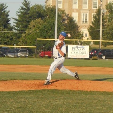 Moeller graduate Phillip Diehl hurls a pitch to...