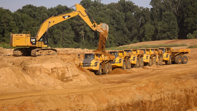 Dump trucks are loaded during construction of the new U.S. 301 on Thursday. The project has been years in the making.