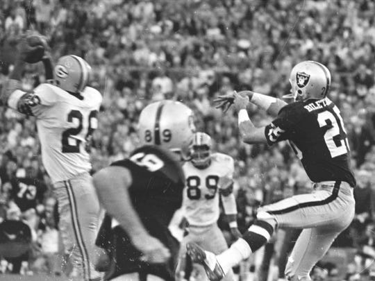 Green Bay Packers cornerback Herb Adderley (26), intercepts a pass intended for Raiders receiver Fred Biletnikoff (25) during the fourth quarter of Green Bay's 33-14 victory over Oakland in Super Bowl II at the Orange Bowl in Miami on Jan. 14, 1968.
