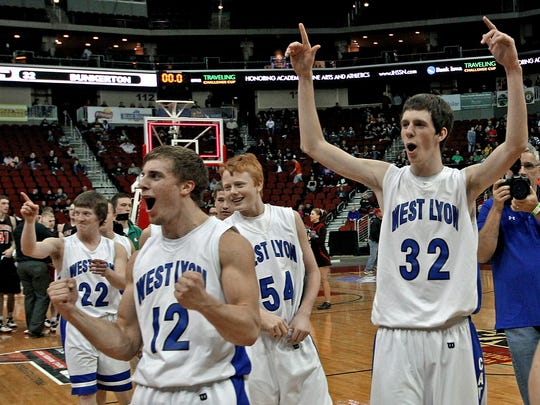 Brandon Snyder (12) celebrates a state basketball title with his West Lyon teammates in 2014. He chose to play football in college, and now has been elevated to the starting free safety spot for the Hawkeyes.