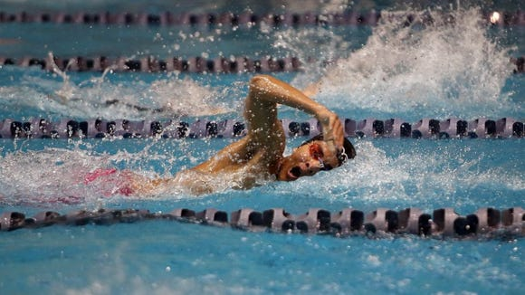 Kingston's Quincy Walker competes in the 50-yard freestyle during the Class 2A state prelims at the King County Aquatics Center in Federal Way last season. Walker is the third Kingston swimmer to qualify as an Ironman this season.