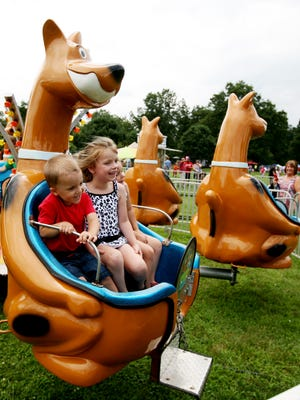 Families enjoy the rides, music and food at the Waynesboro Summer Extravaganza on Saturday, July 11, 2015 at Ridgeview Park.