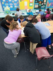 Students participate in a  class activity Friday at Pea Ridge Elementary School. Pea Ridge is at capacity enrollment with 962 students.