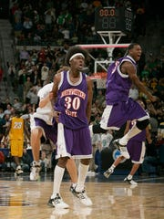 Clifton Lee (30 and Colby Bargeman celebrate Northwestern State's 64-63 win over Iowa in the 2006 NCAA Tournament.