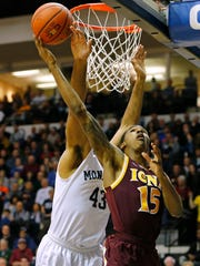 Deyshonee Much of the Iona Gaels attempts a shot as Chris Brady of Monmouth defends during the first half on February 19, 2016.