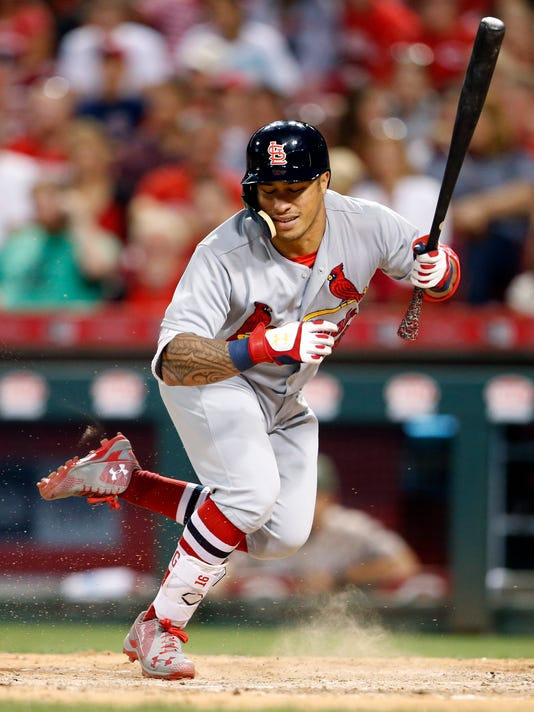 St. Louis Cardinals' Kolten Wong leaps out of the way of a pitch thrown by Cincinnati Reds relief pitcher Michael Lorenzen during the eighth inning of a baseball game, Friday, Aug. 4, 2017, in Cincinnati. (AP Photo/Gary Landers)