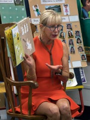 Florida first lady Ann Scott reads to students on Monday,