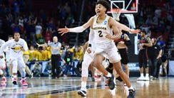 Michigan guard Jordan Poole celebrates with his teammates