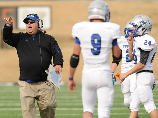 Head football coach Jerry Burkhart compiled a record of 192-10 with eight state titles during a 15-year run at Richland Springs from 2003-17.