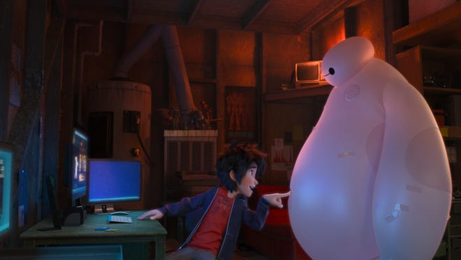 Hiro (voiced by Ryan Potter) and his robot, Baymax (Scott Adsit), recruit a group of would-be superheroes in 'Big Hero 6.'