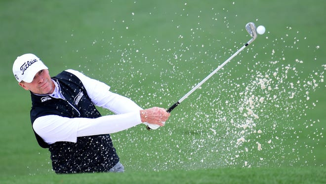 Steve Stricker plays a shot from a bunker on the second hole during the first round of the 2017 Masters Tournament at Augusta National Golf Club in Augusta, Georgia.