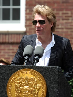 Jon Bon Jovi was joined by Gov. Chris Christie when he donated $1 million to Superstorm Sandy relief in Sayreville on  Monday, July 8, 2013.