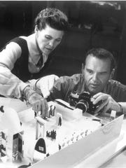 Ray and Charles Eames working on a model for the exhibition