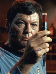 DeForest Kelley as 'Star Trek's' Dr. Bones McCoy holds