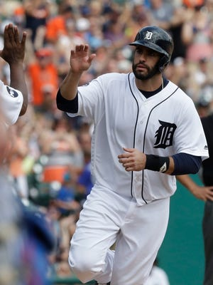 Tigers' J.D. Martinez rounds the bases after his solo home run tied the game in the eighth inning against the Blue Jays on July 16, 2017 in Detroit.