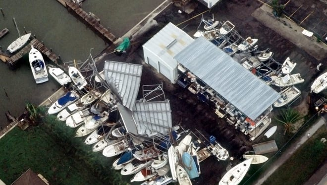Hurricane Andrew took its toll on boats stored at Williams Marina on Isles of Capri, shown in this aerial photograph taken on the afternoon of Aug. 24, 1992, the day Hurricane Andrew devastated much of South Florida. Two racks of dry-docked boats collapsed at the marina, damaging most of the vessels.