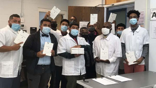 """Barber students at James Sprunt Community College recently were the recipients of a donation of books from Shacklefree Community Outreach Agency in Jacksonville. They received a free copy of """"Outliers: The Story of Success,"""" by Malcolm Gladwell, to help empower, grow professionally and personally."""