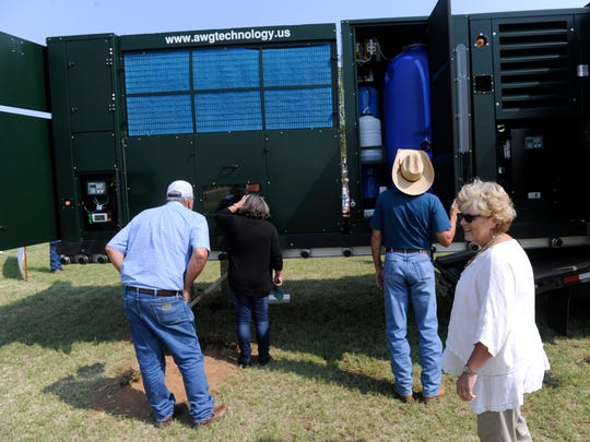 Colorado City residents take a closer look at an atmospheric water generator Wednesday Sept. 6, 2017.