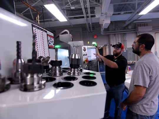 C-TECT instructor Billy Newsom works with student Eric