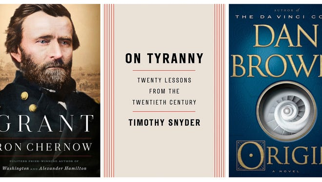 """This combination photo shows popular books released in 2017, from left, """"Grant,"""" a biography by Ron Chernow, released by Penguin Press, """"On Tyranny: Twenty Lessons from the Twentieth Century,"""" by Timothy Snyder, released by Tim Duggan Books, """"Origin,"""" a novel by Dan Brown, released by Doubleday and """"Obama: An Intimate Portrait,"""" by Pete Souza, released by Little, Brown and Company. (Penguin Press/Tim Duggan Books/Doubleday/Little Brown via AP)"""