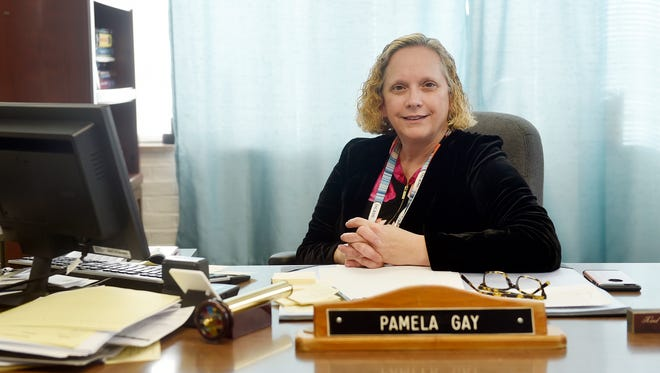 York County Coroner Pam Gay sits for a portrait at her desk Wednesday, Jan. 25, 2017, in the coroner's office in Springettsbury Township. Gay had been in office two months when the number of heroin-related deaths in 2014 exceeded the number from the previous year. Gay has since transformed the coroner's office to battle the opioid epidemic by becoming an advocate for addiction treatment and helping to lead the York County Heroin Task Force (now the York Regional Opiate Collaborative). #weareonenation