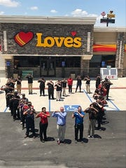 Employees stand in front of the newly opened Love's