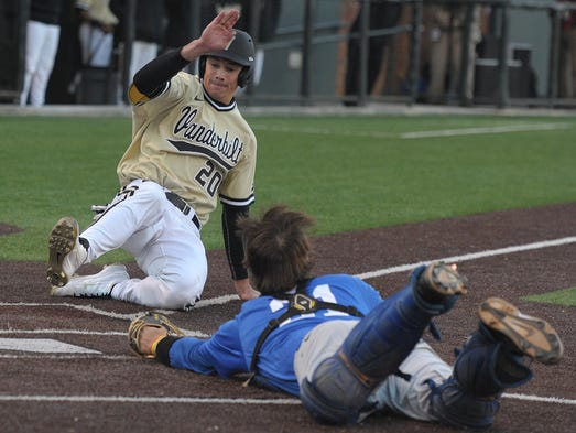 Vanderbilt's Bryan Reynolds beats the throw home as Middle Tennessee State catcher Michael Adkins tries to tag him on Tuesday at Hawkins Field in in Nashville. Vanderbilt defeated MTSU, 19-1.