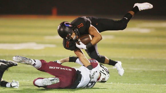 Sprague's Noah Mellen collides with Sherwood's Kameron Price in the second round of the OSAA Class 6A state playoffs on Friday, Nov. 11, 2016, at Sprague High School.