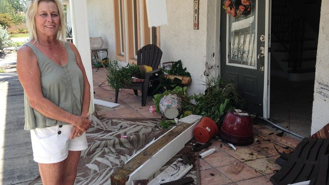 Gail Fischer stands in front of her Indialantic home, which was hit by a car.