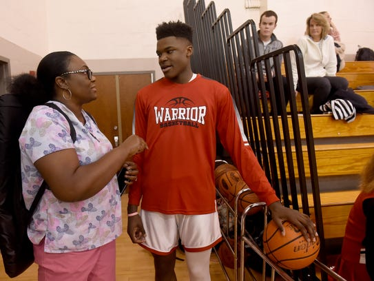 Marcia Walker talks with her son, Jarace, 14, about