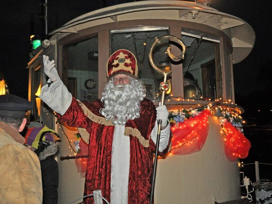 """Sinterklaas boards a tugboat in Kingston that will deliver him to """"Spain"""" (Rhinecliff) as he prepares for the event there during a past event."""