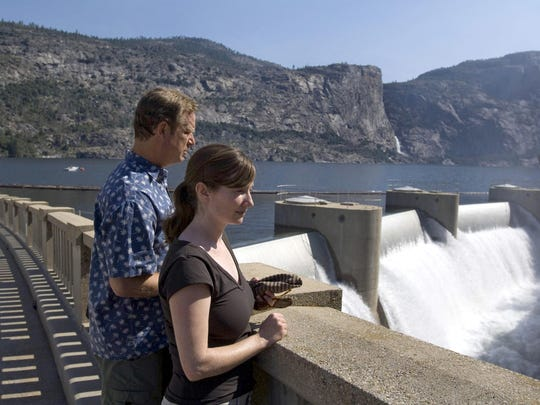 In this 2006 file photo, people look over O'Shaughnessy Dam and Hetch Hetchy reservoir near Yosemite National Park.