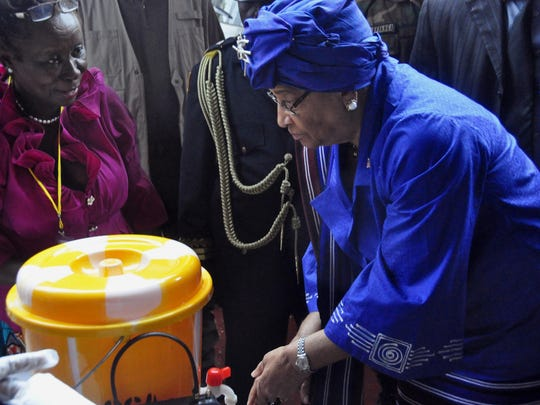 In this photo taken on Saturday, Liberia President Ellen Johnson Sirleaf demonstrates how to wash hands properly in order to prevent the spread of the Ebola virus.