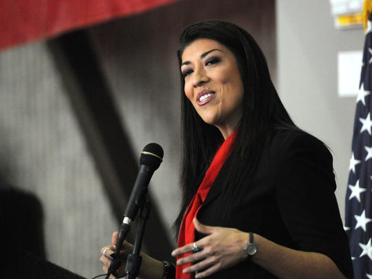 In this 2014 photo, Lucy Flores speaks in North Las Vegas.