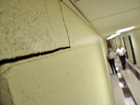 In this file photo, A crack in a first floor hallway of the Salisbury Police Department after an earthquake was felt through the region in August 2011.