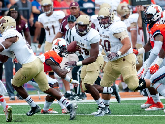 Texas State running back Robert Lowe (28) runs the ball during the first quarter of an NCAA college football game against Illinois Saturday, Sept. 20, 2014, at Memorial Stadium in Champaign, Ill. (AP Photo/Bradley Leeb)