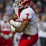 Running back Robert Martin. The Scarlet Knights compete against themselves during the Friday Knight Lights game at High Point Solutions Stadium. Piscataway, NJ Friday, April 24, 2015 Doug Hood/Staff Photographer @dhoodhood