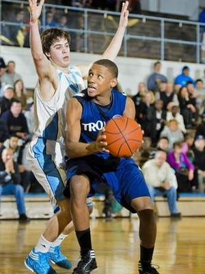 Former East Lansing guard Javon Haines (right) broke the Lansing Community College men's basketball single-game scoring record with 55 points on Saturday.