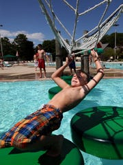 Jaxin Osinski, 9, visiting from O'Fallon, Missouri, maneuvers an obstacle course  at  Cool Waters Family Aquatic Park in Greenfield Park.