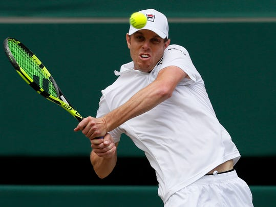 Sam Querrey of the United States returns to Croatia's Marin Cilic during their Men's Singles semifinal match on day eleven at the Wimbledon Tennis Championships in London, Friday, July 14, 2017. (AP Photo/Kirsty Wigglesworth)