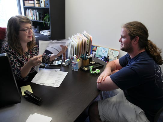 Emily Buis, a guidance counselor, meets with  Daniel