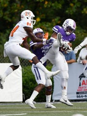 Furman's Joe Farrar (5) intercepts a Mercer pass in the closing seconds to seal victory.