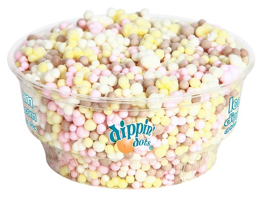 A cup of Banana Split Dippin' Dots ice cream.