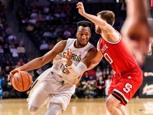 Georgia Tech guard Josh Okogie, left, drives to the basket as North Carolina State guard Braxton Beverly defends in the first half of an NCAA college basketball game, in Atlanta, Thursday, March 1, 2018. (AP Photo/Danny Karnik)