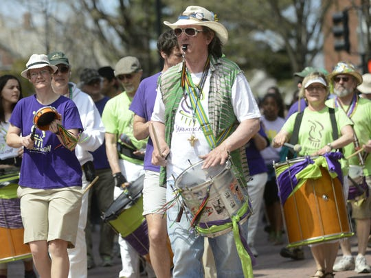 Samba street band Sambatucada leads COTS Walk participants down Church Street in Burlington on Sunday.