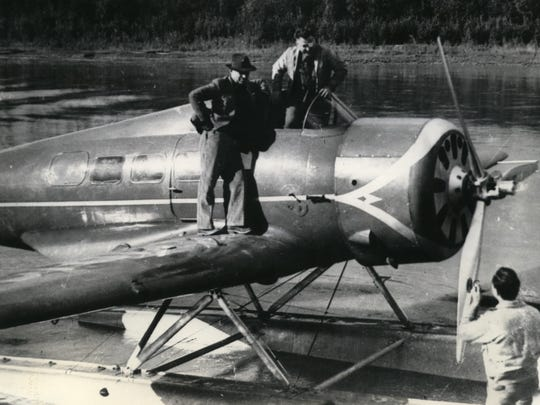 Will Rogers (left) and Wiley Post pose for a photographer on Aug. 15, 1935, in Fairbanks, Alaska, on the plane that would carry them to their deaths a few hours later.