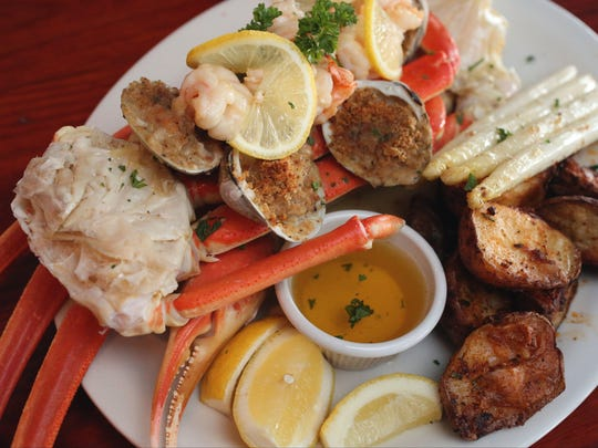 The Captain's Platter, baked whole clams oreganato, shrimp scampi and snow crab at Captain Jake's on Front Street in Newburgh, April 6, 2017.